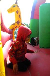 Children having fun on inflatable zoo in Nagoa beach