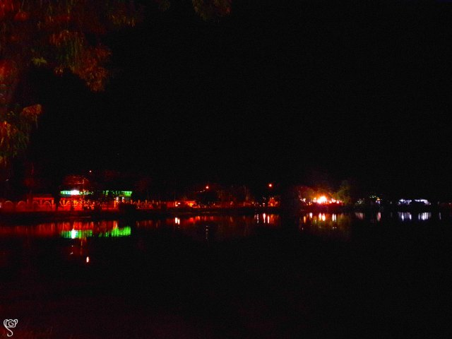 Reflection of the fair on the lake waters