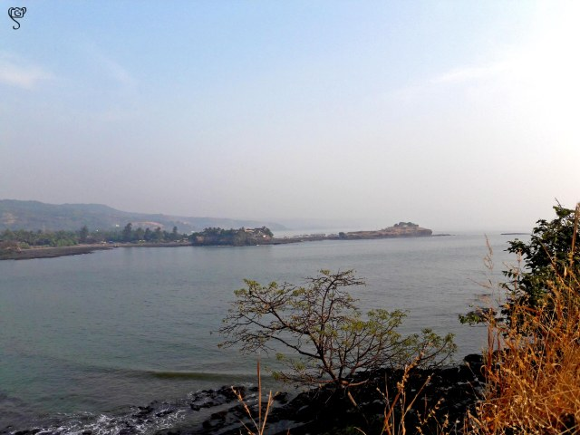 The land projecting into the sea with the Kanakadurg Fort