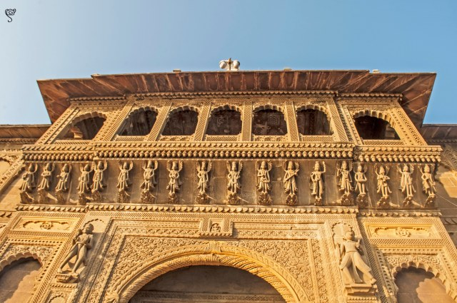 The intricate carvings on the ancient structures by the Ghat