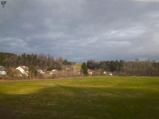The greenery around the city, captured from the train