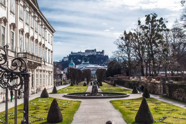 The Mirabell Palace on the left with the garden and the Hohensalzburg Castle on the hill