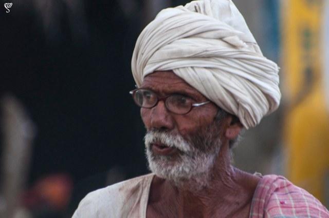 An elderly villager looks for his cattle