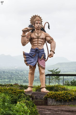 The huge Hanuman guards the hills on the way to the windmill farms