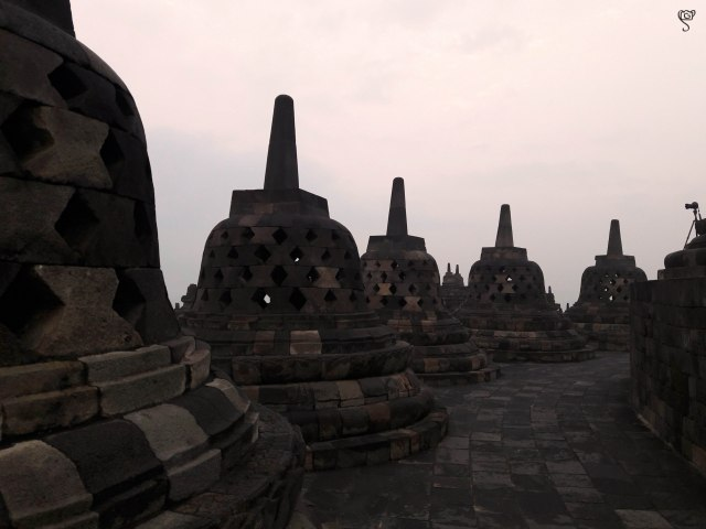 The stupas with the statue of Buddha within