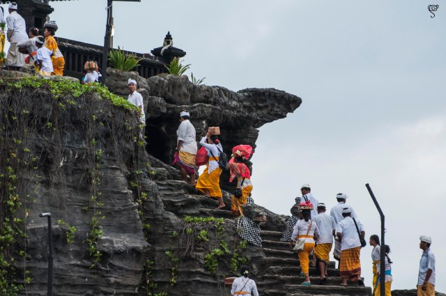 Devotees climbing the stairs to the temple