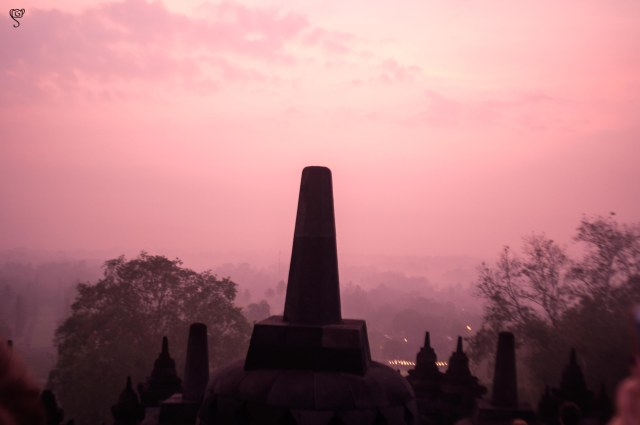 The silhouette of the stupas with the backdrop of the red sky