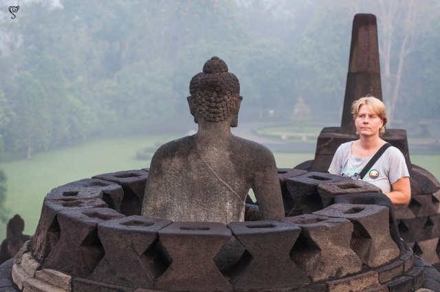A co-traveller of the sunrise tour with the batch, admiring the Buddha
