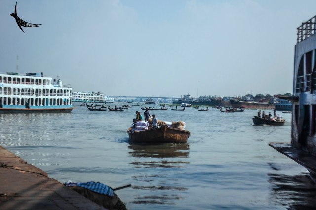 A boat carrying cargo in Sadarghat