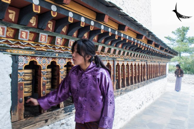 A young devotee rotating the prayer wheel at Changankha Lhakhang