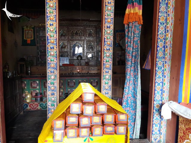 The traditional temple in his house