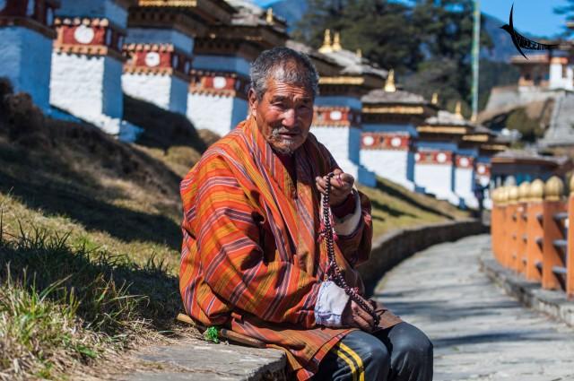 An elderly man chanting hymns