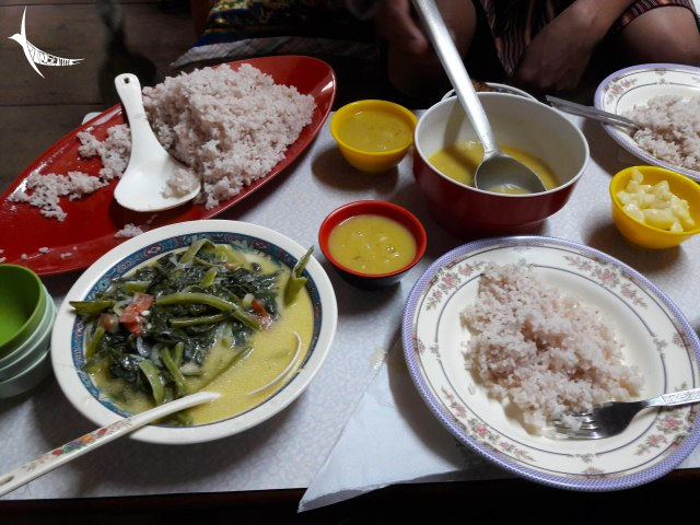 The homely lunch comprising of red rice, spinach datshi, kewa datshi and dal
