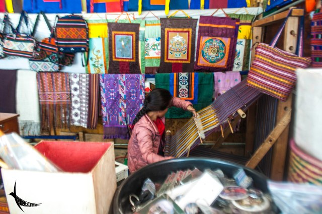 The lady in her handicrafts shop which is one among the 108 shops in the heart of the city
