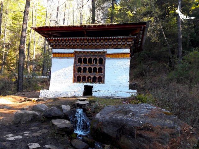 The stupa with the prayer wheel rotated constantly by the running water of the spring