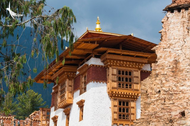 The renovated part of the Drugyel Dzong with the ruins of the old wall on the right
