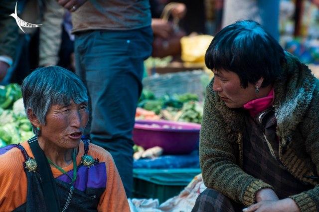 Ladies busy in conversation in the Paro weekend market