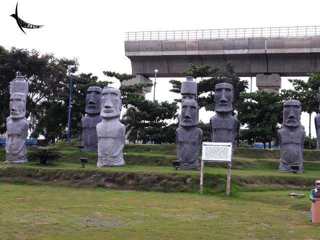 The under-construction fly-over in the backdrop of Moai Statues of Easter Island