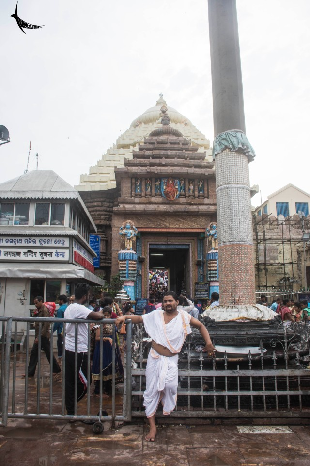 A priest posing in front of the Jagannath Temple