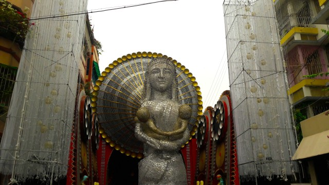 'Ma' in Bengali and Hindi made up this sculpture of the Mother with her child in front of the Puja Mandap