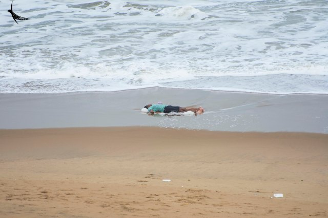Father daughter playing dead on the beach