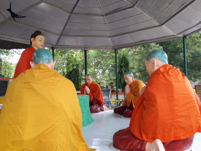 Replica of Buddha giving his first sermon to his first five disciples