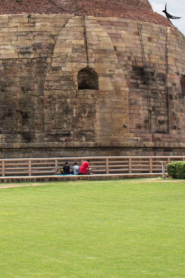 Students studying at base of the Dhamek Stupa