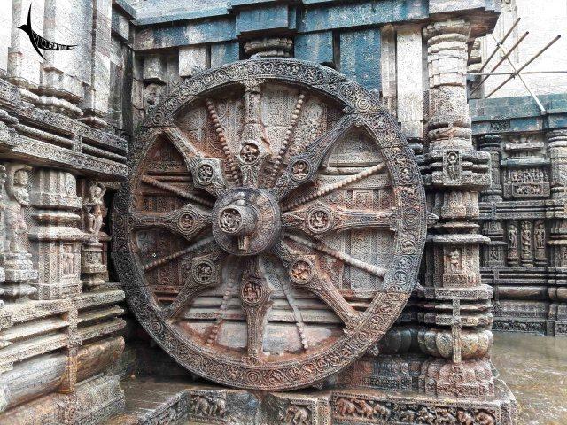 Intricately engraved wheels of the stone chariot in Konarak