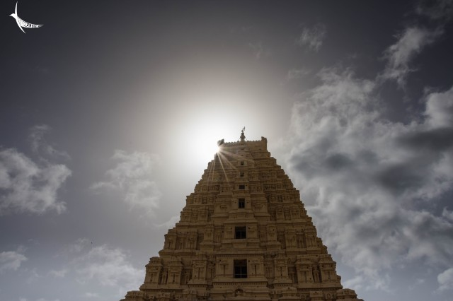 The sun behind the Gopura of the Virupaksha Temple