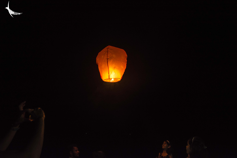 Children delightfully watches the lantern flying high