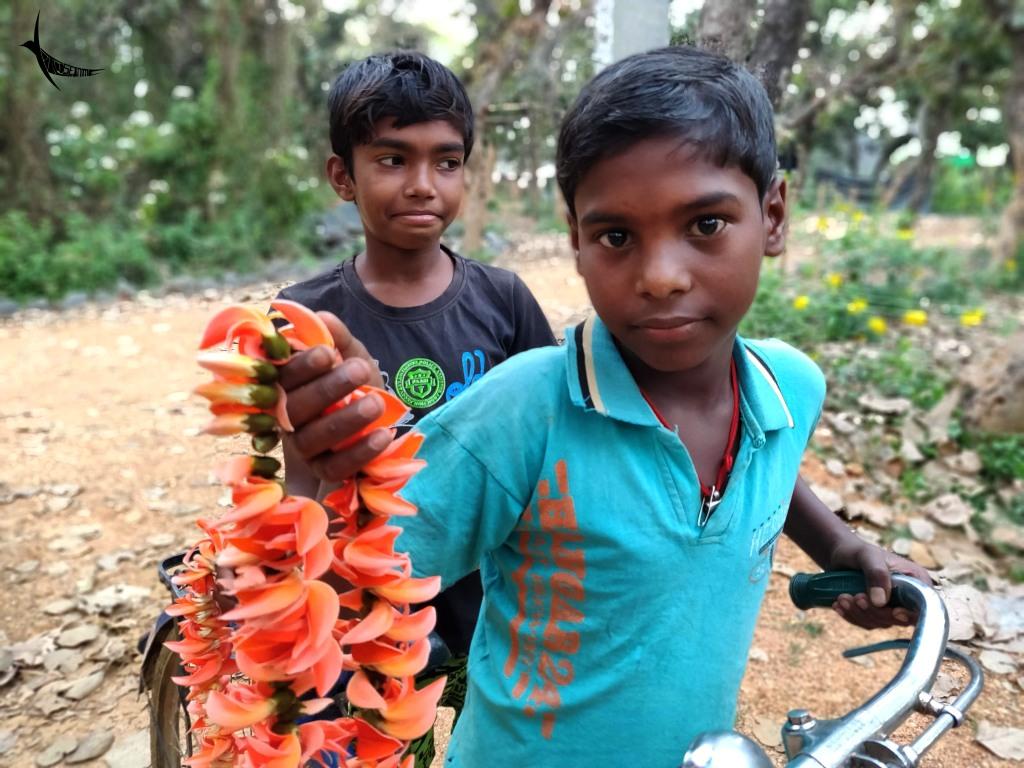 Lakhai (front) and Ashim (back) selling Palash garlands in Palashbari Resort