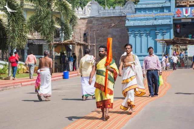 A holy man walks in front of the Simhachalam Temple