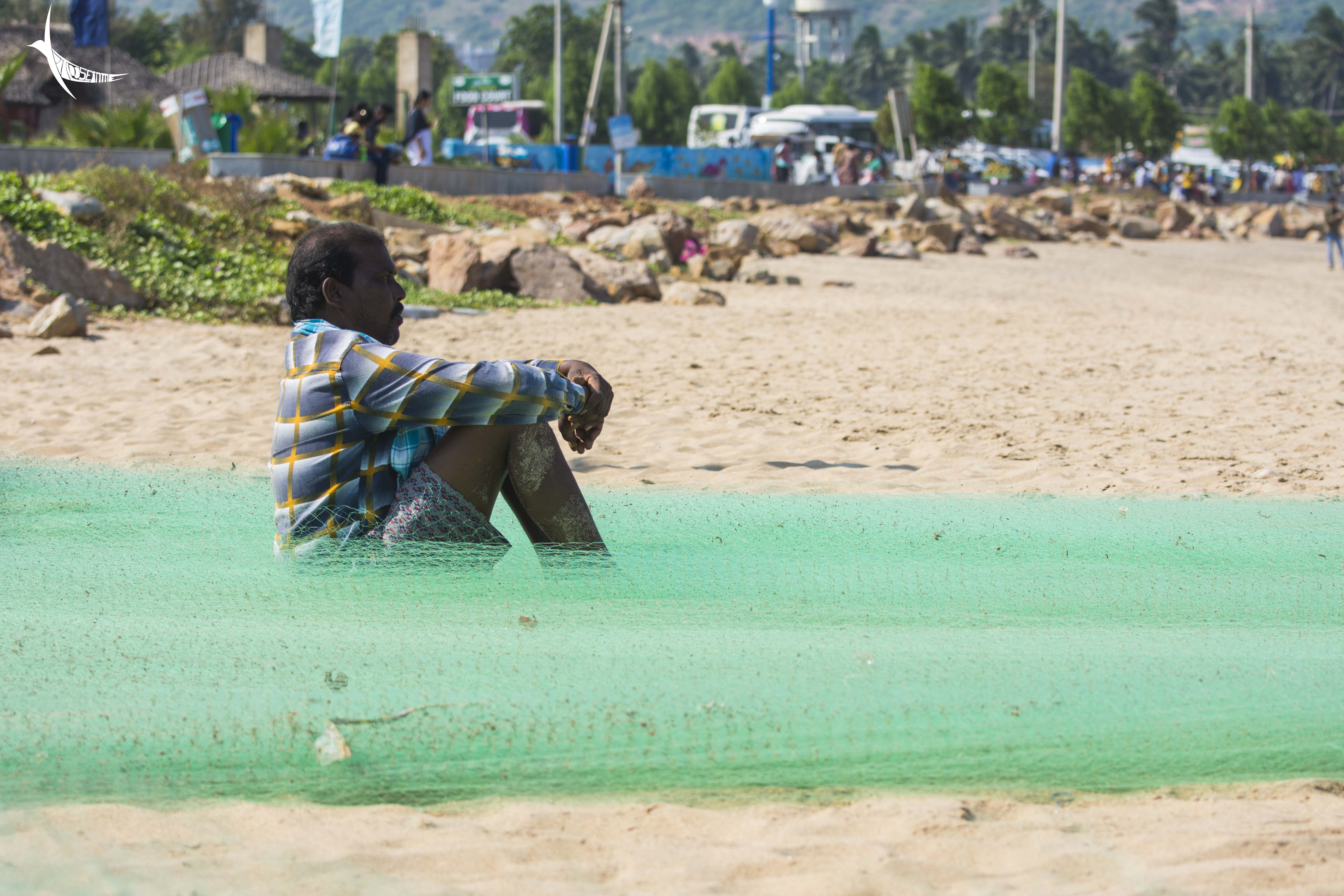 Drying themselves and their nets