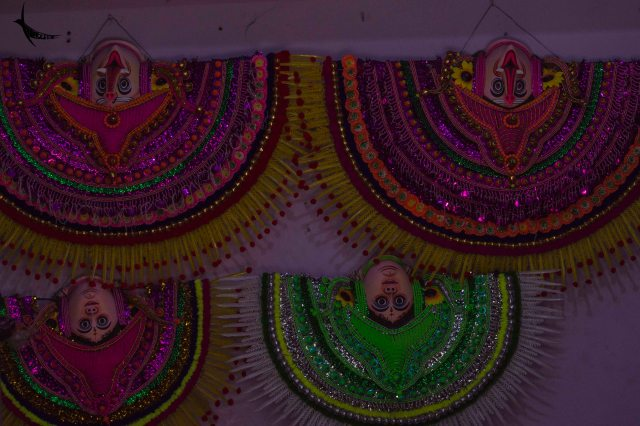 Chhau masks hanging upside down