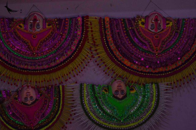 Chhau masks hanging upside down