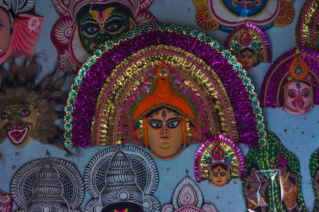 Babu mask in the centre with animal masks and bhoot masks around