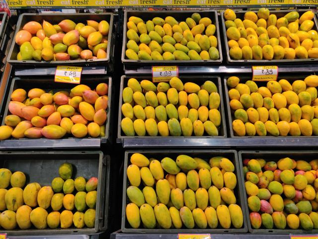 Different variety of mangoes for sale in supermarket