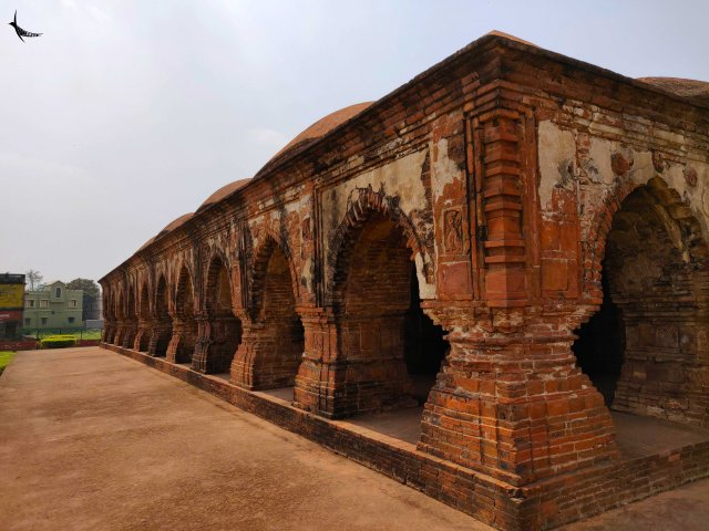Rasmancha was built by Bir Hambir in 1600 AD. The temple stands on a raised square laterite plinth with a pyramidal superstructure, three circumbulatory the arches of which are decorated with terracotta lotus motifs enclose the shrine. Its parallel has not been found anywhere in India and it may be considered as the pride of Bishnupur for its unique structure.
