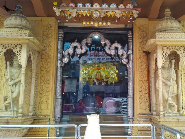 The Dagduseth Ganapati as seen from outside through the glass window