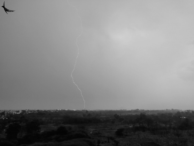 The lightning strikes as the pre monsoon shower washes the city