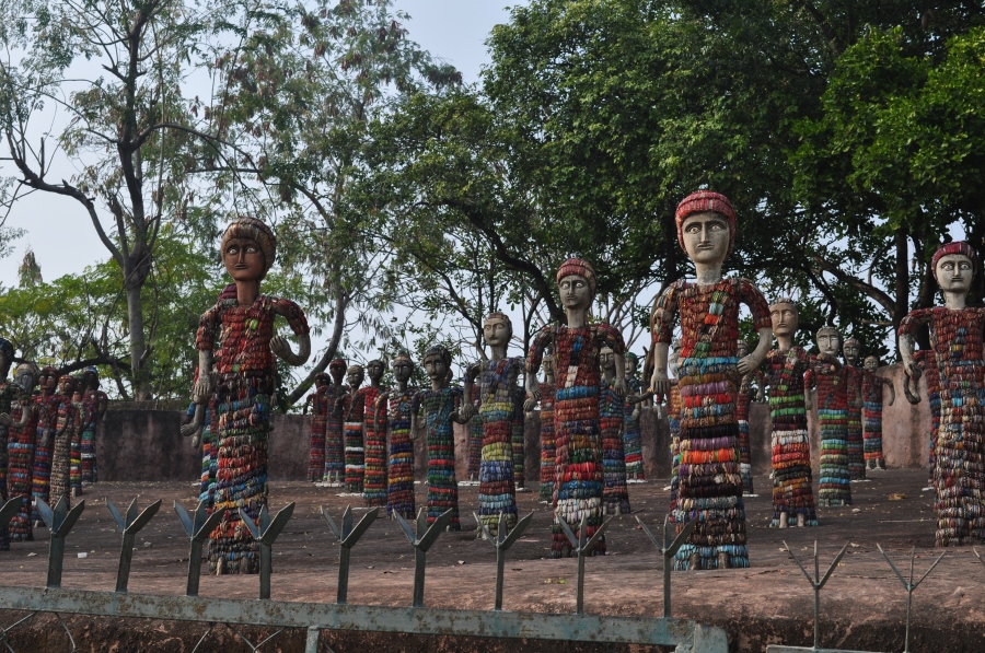 Sculptures of man, made of broken pieces of bangles