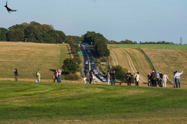 Tourists and the long queue of vehicles in Stonehenge